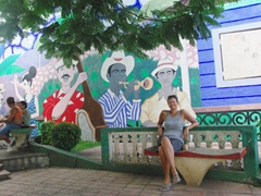 Becky relaxing next to our favorite mojito spot in Baracoa