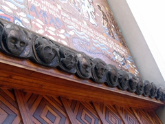 Carved faces over the entrance to Port Moresby's Parliament Haus
