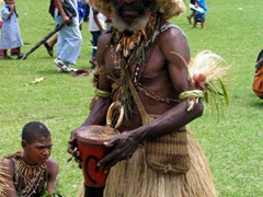 Preparing his drum for the next sing-sing
