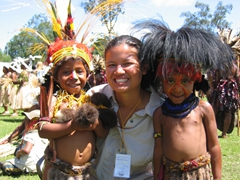 Becky tickles her two favorite children at the Goroka Show