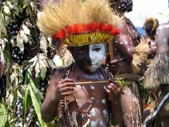 A young tribe member poses for a photo between dances