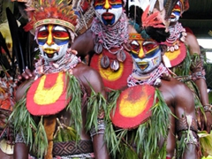Close up of the Mount Hagen tribes seeking refuge from the rain on Day 2 of Goroka Festival
