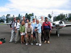 Lawrence and the Wontok Clan in front of the tiny Beachcraft Baron plane