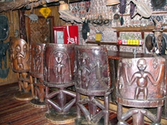 Hand carved bar stools at Karawari lodge