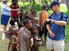 Scott and Gene show the village children their own images