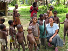Becky posing with some friendly Amungari kids