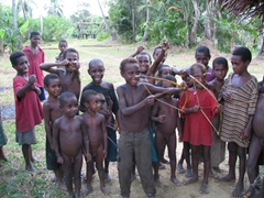 Children showing us their best bow and arrow technique; village along the Karawari river