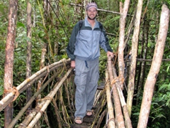 Robby on a jungle bridge made of vines near Ambua lodge