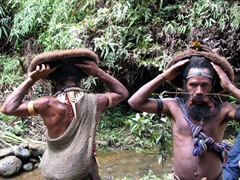 Huli wig school students demonstrating that the hair is real and still attached to their head
