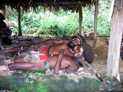 What an uncomfortable way to sleep! The sacrifices of the Huli Wigmen, Tari