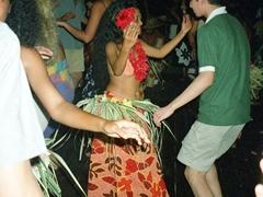 Luke shaking his hips next to a Tahitian beauty
