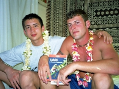 Luke and Robby wearing their welcome leis; Dream Island