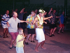 Robby leading the men in a Tiki Village dance off