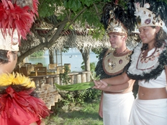 Binding the ceremony with coconut leaves - our Tahitian wedding at Tiki Village