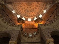The interior of Yeni Cami is decorated with detailed tile work