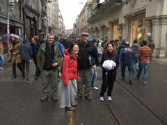 Robby, Ichi, Bob and Ann pose on a section of Istiklal Avenue as a tram slowly approaches
