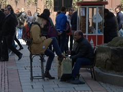 A happy customer getting his shoes shined; near Galata Tower