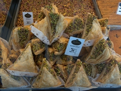 Pistachio baklava treats, made with flaky phyllo pastry layered with pistachios and drenched in honey