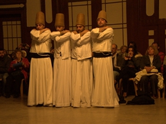 Four dervishes preparing to whirl for 30 minutes