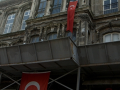 Turkish flags hanging from the fascade of this decrepit beauty
