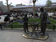 "Bronze statue of ""The Simit Seller""; near New Mosque. Simit is the wheel-like bread otherwise known as a Turkish bagel"