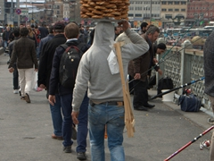 A simit vendor crossing the Galata Bridge
