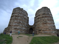 Becky is dwarfed by the massive remnants of Yoros Castle; Anadolu Kavagi