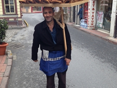 A simit seller proudly stops for a photo; Sultanahmet