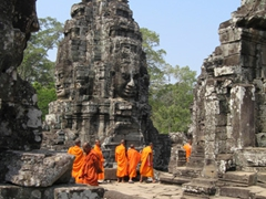 Monks wandering around the Banyon ruins