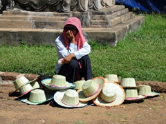 Hats for sale but the vendor opts for a scarf!