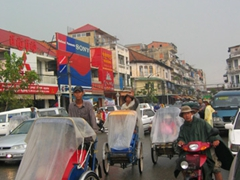 Cyclos during a heavy downpour in Phnom Penh