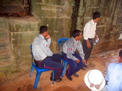 During the torrential downpours, even the security guards seek refuge under the temple shelter at Banteay Kdei