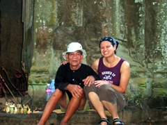 Becky posing with the old man from the cover of Lonely Planet Cambodia (can you believe LP didn't even ask for permission to put his image on their book cover nor compensate him financially? Shame on them!)