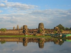 An afternoon photo of Angkor Wat complex reflected in its moat