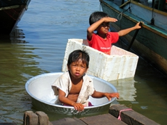 These entrepreneurial boys found anything that would float to hustle Tonle Sap visitors