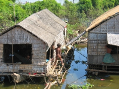 Clothing is optional for this boy as he hops from one floating house to another; Tonle Sap