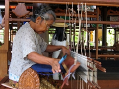 A Cambodian woman shows off her dexterity in making a beautiful tablecloth