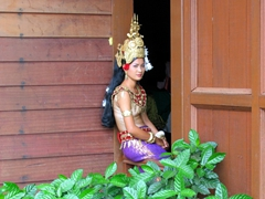 An apsara dancer takes a breather in a window frame