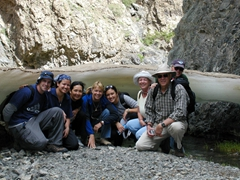 Its a Clark clan portrait beside a natural ice bridge in the Gobi Desert; Gurvansaikhan National Park