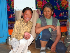 Our Mongolian hosts laugh at our reaction to the snuff bottle