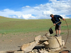 Our Mongolian host shows us how the family obtains water in the middle of the Gobi Desert