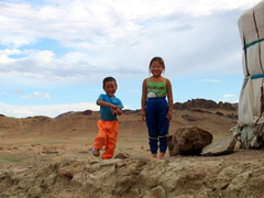 Two happy children pose for a photo, near Saikhan Ovoo Wild Ger Camp
