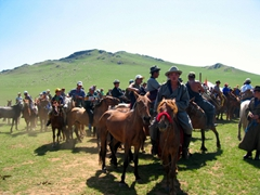 It is the end of the race, and the riders are dispersing; Regional Naadam Festival