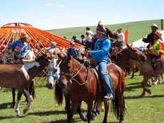 Another female jockey at a regional Naadam festival
