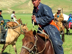 This Mongolian rider cut a fine figure on his horse; regional Naadam Festival