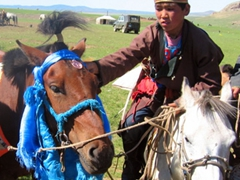 Once the riders caught wind that tourists were witnessing the race, they started approaching us to pose with their horses for photos; local Naadam Festival