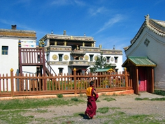 A monk strolls towards the Laviran Temple at Erdene Zuu monastery