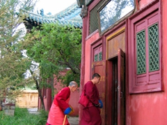 Monks entering a temple at the Gandan Monastery complex