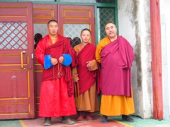 Three monks welcome us to the Gandantegchinlen Monastery Complex