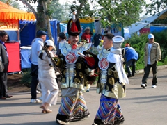 Mongolians dressed in their respective costumes head towards the Naadam Stadium to partake in the opening ceremonies